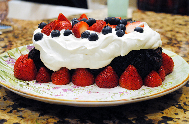 chocolate loaf cake with berries and cream